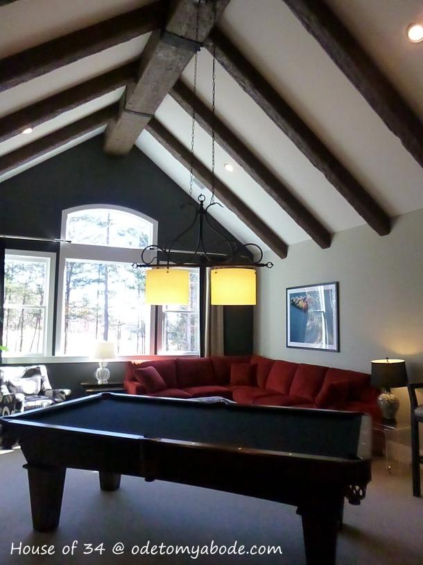 pool room with wood beams